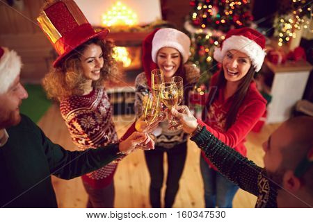 Young people toasting with drink on New Year celebration
