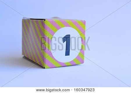 small stripey cardboard box with the number one 1 printed on it
