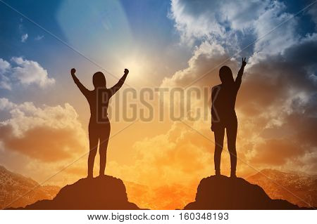 Silhouette Of Winning Success Woman At Sunset Or Sunrise Standing And Raising Up Her Hand In Celebra