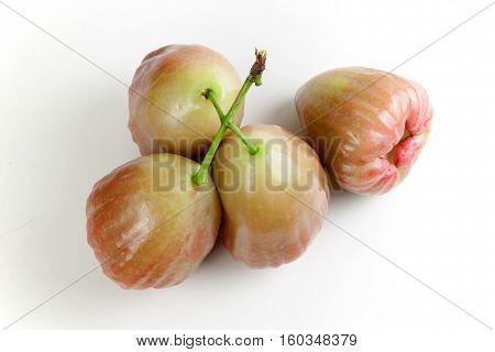 green rose apple (chomphu) on white background. Fruit heart shape.