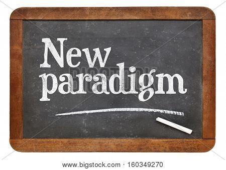 New paradigm  - white chalk text on a vintage slate blackboard