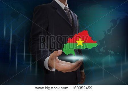 Businessman showing map of Burkina Faso on globe background