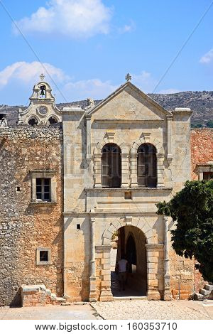 ARKADI, CRETE - SEPTEMBER 15, 2016 - Elevated view of the Western wall entrance to the Arkadi Monastery with part of the bell tower to the rear Arkadi Crete Greece Europe, September 15, 2016.