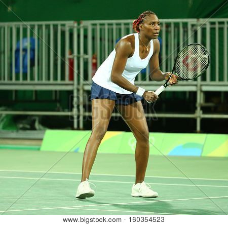 RIO DE JANEIRO, BRAZIL - AUGUST 7, 2016: Olympic champion Venus Williams of United States in action during doubles first round match of the Rio 2016 Olympic Games at the Olympic Tennis Centre