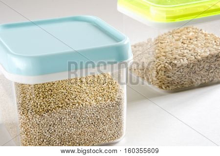 Food storage. Food ingredients (quinoa and wild rice) in plastic containers. Selective focus.