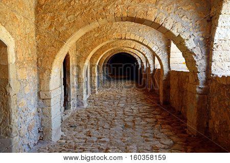 ARKADI, CRETE - SEPTEMBER 15, 2016 - Passageway in the West Gate (Klaoustra) at the Arkadi Monastery Arkadi Crete Greece Europe, September 15, 2016.