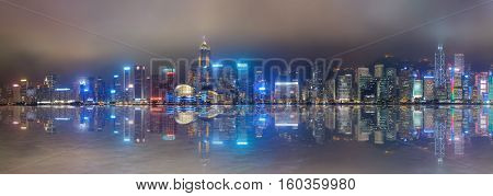 Hong Kong foggy night on Victoria's harbour from Tsim Sha Tsui waterfront poster