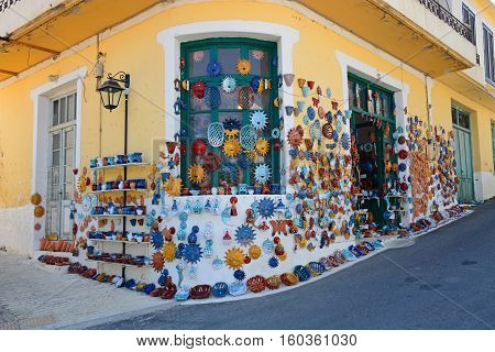 MARGARITES, CRETE - SEPTEMBER 15, 2016 - Pottery displayed on the wall of a shop in the village centre Margarites Crete Greece Europe, September 15, 2016.