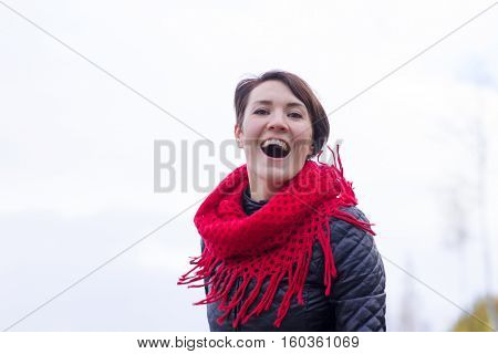Happy Girl In Red Scarf Outdoor