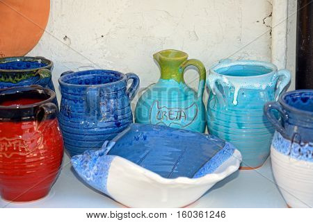 Cretan pottery displayed outside a shop in the village centre Margarites Crete Greece Europe.