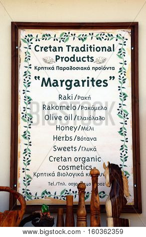 MARGARITES, CRETE - SEPTEMBER 15, 2016 - Cretan traditional products sign displayed outside a shop in the village centre Margarites Crete Greece Europe, September 15, 2016.