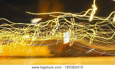 Electricity from car moving blur in night times on express way at Bangkok Thailand for background.