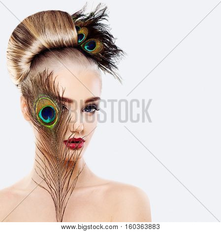 Glamorous Blonde Woman with Perfect Hairstyle Makeup and Peacock Feathers