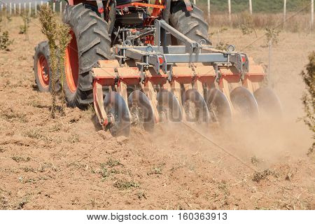 Close up of a disc harrow system cultivate the soil