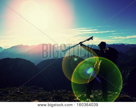 Lens Flare Defect. All Backpacker With Poles In Hand. Sunny Weather In Rocky Mountains.