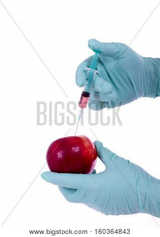 GMO food genetically modified fruit and syringe with colorful chemical Injection into apple