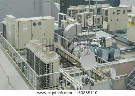 GINZA JAPAN 18 NOV 2016: Industrial steel air conditioning and ventilation systems on building rooftop