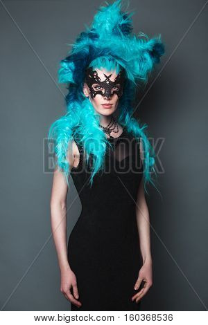 Beautiful girl in evening dress with avant-garde hairstyles. Beauty the face. Photos shot in the studio.
