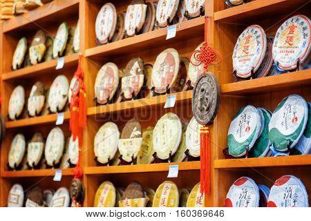 Disks Of Post-fermented Tea Yunnan Puer At Shop, Lijiang