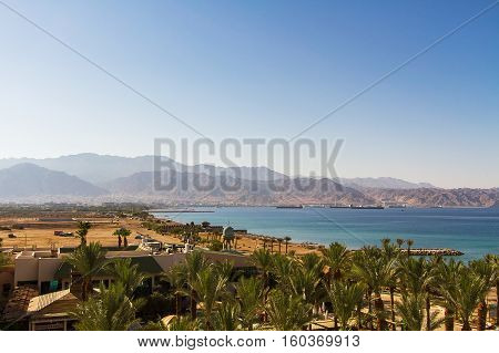 View of Aqaba and the mountains behind it from the sea .