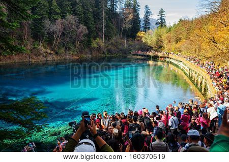 Crowd Of Asian Tourists Taking Pictures Of The Five Coloured Pool