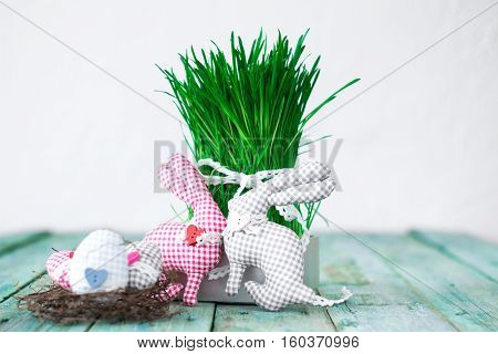 Green Grass Sprouts With Bright Colored Eggs On A Wooden Background. Selective Focus , Easter Concep