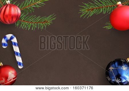 red wavy dull and blue ball stick on dark background with Christmas fir branch