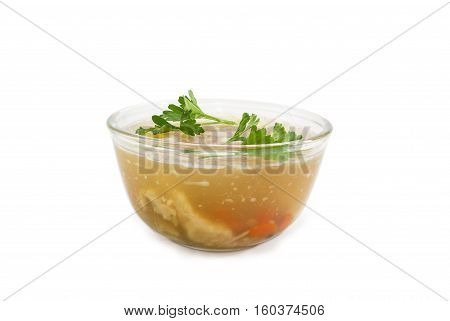 Pork aspic with two twigs of parsley in transparent glass bowl on a light background