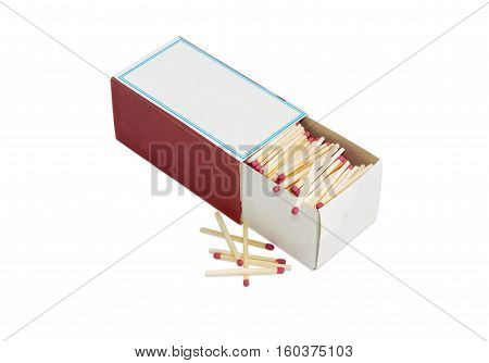 Household safety matches made from wood in large cardboard matchbox and several matches beside on a light background