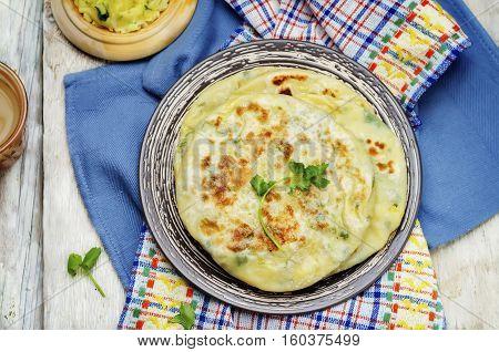 Healthy Indian Potato stuffed Flatbread. Aloo Paratha.