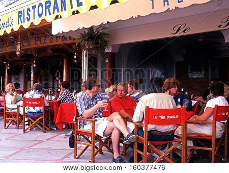 AMALFI, ITALY - SEPTEMBER 22, 1996 - Tourists relaxing at a pizza restaurant along the promenade Positano Amalfi Coast Italy Europe, September 22, 1996.