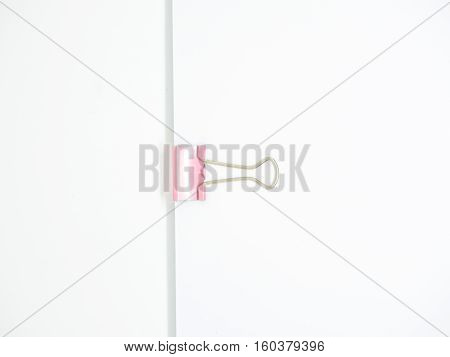 Pink Paperclip Attached On White Paper Isolated