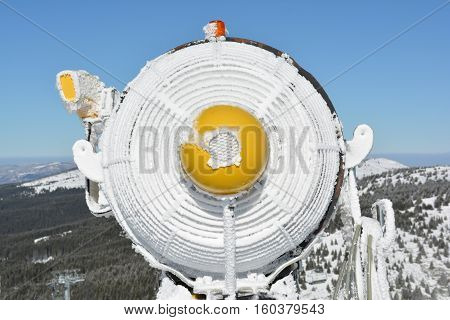 sFrozen Snow gun with hoarfrost on the top of mountain Kopaonik Serbia close up view from behind