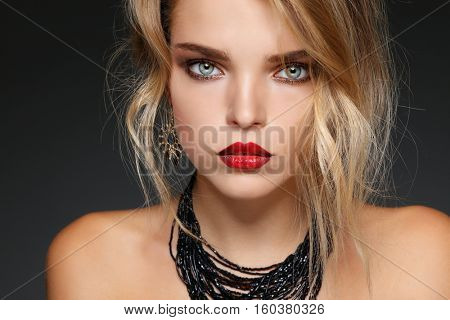 Fashion girl portrait  on a grey background.Accessorys. Long curly hairs