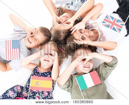poland group holding flags of different countries. German flag, flag england, spain flag, flag of america, flag of russia, france flag, flag canada