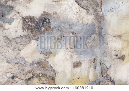 White old painted wall with damaged plaster texture background