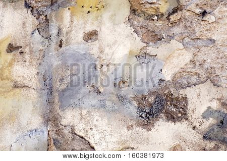 White old grunge wall with damaged plaster texture background