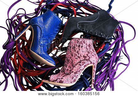 Ukraine Kiev - August 25 2016: Bright blue burgundy lace and black fur ankle boots. Footwear of three different colors and materials