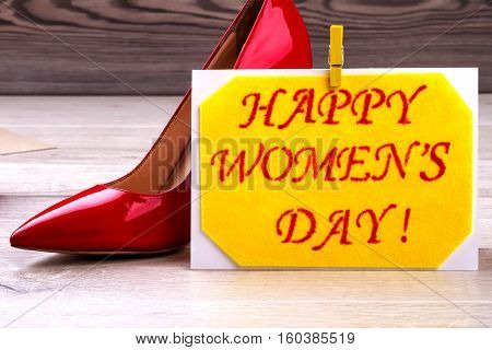 Women's Day card and shoe. Clothespin on fabric greeting card. Fashion as part of celebration. Creativity on every holiday.