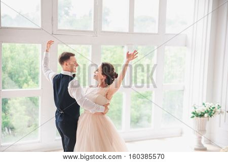 First Wedding Danc.wedding Couple Dances On The Studio. Wedding Day. Happy Young Bride And Groom On