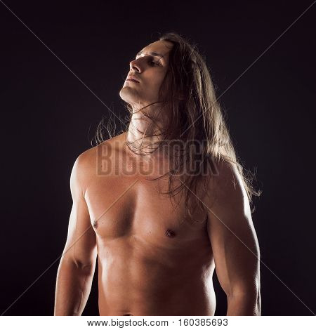 Attractive young male, athletic body type, long hair