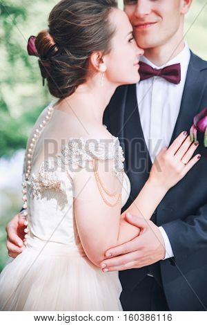 Groom And Bride Together. Wedding Couple. Wedding Day. Beautiful Bride And Elegant Groom Walking Aft