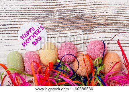 Mother's Day card and sweets. Greeting paper, candies and streamer. Impress mom by homemade confectionery.