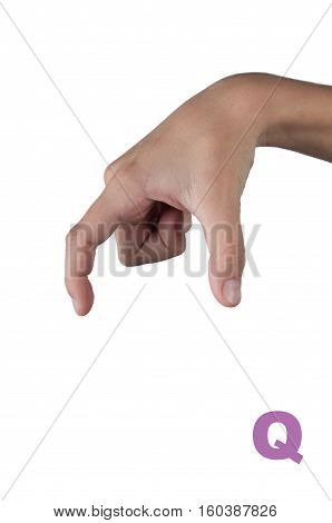 Symbol Q in gesture language. Letter made by human hand isolated on white
