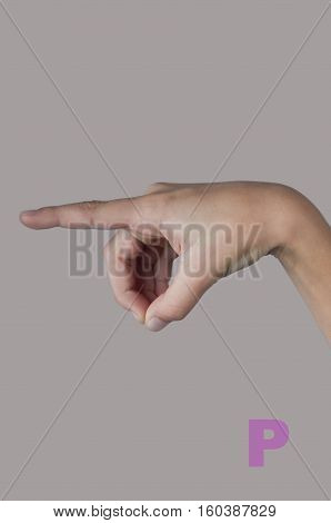 Nonverbal language. Letter P made by human fingers on grey background