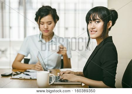 Young females working in an office together