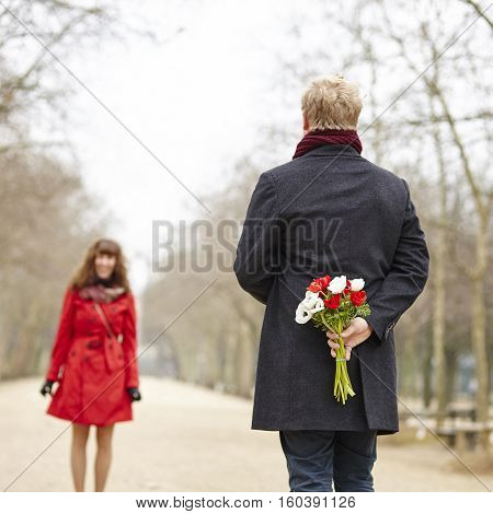 Man Is Going To Offer Flowers To His Girlfriend