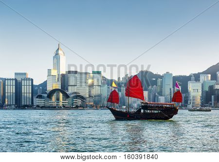 Traditional Chinese Sailing Ship In Victoria Harbor At Evening