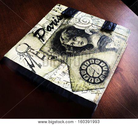 Book shaped secret casket. decoupage book case on the table