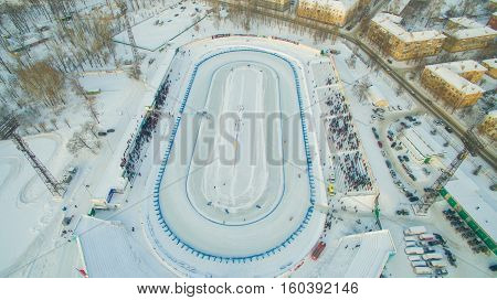 Motorcyclists, riders compete in races on the ice at the stadium. Winter speedway. Aerial view